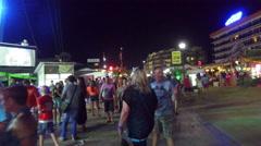 Night Walk Pov of Sunny Beach with people walk Stock Footage