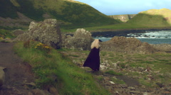 4k Fantasy Shot on Giant's Causeway of a Queen Standing in the Wind Stock Footage