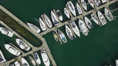 Horizontal flight looking straight down at Sandringham marina boats Stock Footage