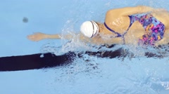Professional Female Swimmer Training in Swimming Pool Stock Footage
