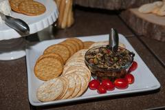 Crackers and olive dip appetizer Stock Photos