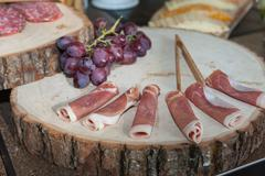 Rolled sandwich meat on buffet table Stock Photos