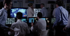 Security personnel in a busy system control room Stock Footage