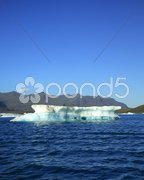 Blue sky and iceberg Stock Photos
