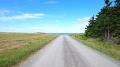 Aerial shot of farm field and rocky ocean coast in Cape Breton Stock Footage