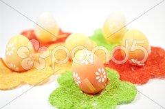 Muster mit Strohblumen und Eiern Stock Photos