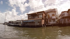Poor house on the water. River in Bangkok, Thailand Stock Footage