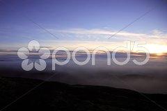 Sunset over a canopy of cloud Stock Photos