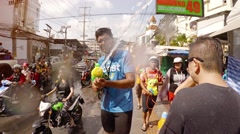 Strangers dousing each other in the streets for Songkran Festival in Thailand Stock Footage