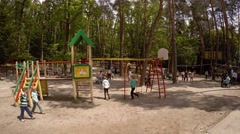 Children playing on the playground at Goloseevo District Park in Kiev Stock Footage