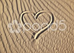 Sand heart Stock Photos