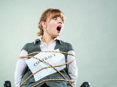 Afraid businesswoman bound by contract terms. Stock Photos