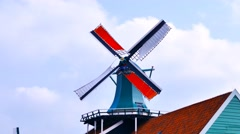 Classic Dutch windmill at Famous tourist location of Zaanse Schans Stock Footage