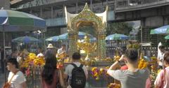Tourists at Altar Erawan in Bangkok, Thailand Stock Footage
