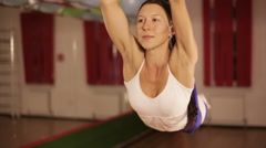 Anti-gravity Yoga, woman doing yoga exercises indoor Stock Footage