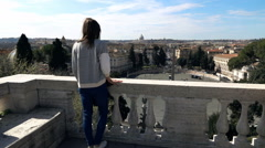 Young woman admire Italian cityscape on terrace in Rome, Italy Stock Footage