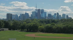 Toronto Skyline Buildings Riverdale Track Field Runners Exercising Park Day Stock Footage