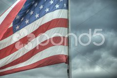 U.S.A. Flag against the stormy weather Kuvituskuvat