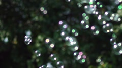 Many small bubbles scatter in different directions. Soap bubbles show Stock Footage