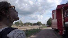 MILLENNIAL COLLEGE GIRL WALKING SIDEWALK ALONG TRAINS SLOW MOTION HAPPY Stock Footage