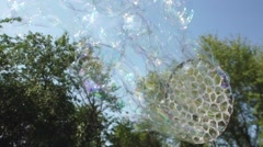 Create a whimsical bubble with the device. Bubbles Flying in the Sky Stock Footage