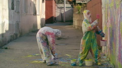 Splatter Painting Wall in Street Stock Footage