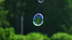Two small soap bubbles flying and shining. Metamorphosis of Bubbles Stock Footage