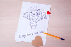 Figure energy-saving light bulbs. Shine Stock Photos