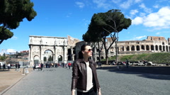 Young woman sightseeing, walking near Colosseum, Rome, slow motion 240fps Stock Footage