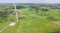 Wind turbines in green fields Stock Footage