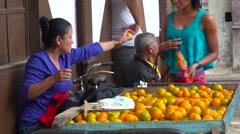 A woman sells fruit from a cart along the street in havana, Cuba. Stock Footage