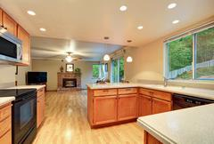 Interior design of nice kitchen room with the living room view. Open floor pl Stock Photos