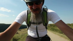 Man riding mountain bicycle outdoors Stock Footage