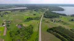 Road in the land of fields and lakes Stock Footage