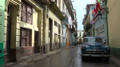 The old city of Havana, Cuba after the rain with classic old car foreground. Stock Footage
