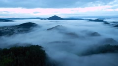 Time lapse. Hilly landscape. The fog is moving over treetops of forest. Stock Footage