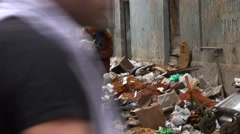 A man collects garbage along the streets of Havana, Cuba, Stock Footage