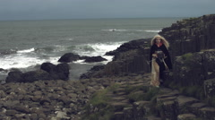 4k Fantasy Shot on Giant's Causeway of a Queen Looking  Standing in Wind Stock Footage