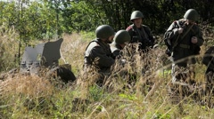 Soldiers rest with near anti tank gun Stock Footage