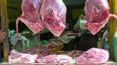 Raw meat hangs from a stall along a street in Havana, Cuba. Stock Footage