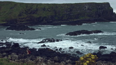 4k Fantasy Shot on Giant's Causeway of a Queen On the Rocks (extremely long shot Stock Footage