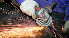 Close up shot worker with grinder grinds metall with sparks Stock Footage