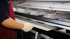 Close up shot operator bending metal sheet by sheet bending machine Stock Footage