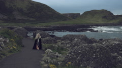 4k Fantasy Shot on Giant's Causeway of a Queen Walking to Camera Stock Footage
