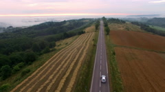 Aerial View Of Car On Foggy Rural Road Stock Footage