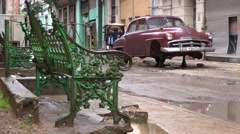 An old car stands on blocks in the old city Havana Cuba. Stock Footage