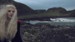 4k Fantasy Shot on Giant's Causeway of a Queen Walking Away Stock Footage