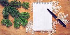 Pen and Notepad on old rustic table decorated with a fir branch. Stock Photos