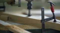 Working with wood to design a wooden car Stock Footage