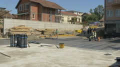 Waterproofing of building foundation, workers at construction site by Sheyno. Stock Footage